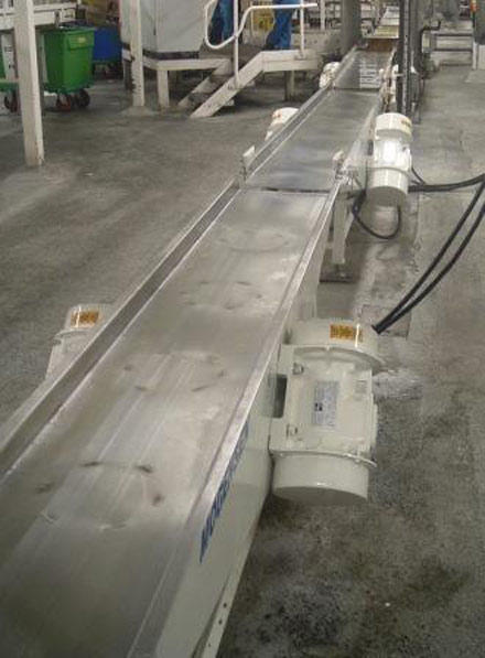 Mogensen TSL Feeder: Used to settle product to reduce volume prior to boxing